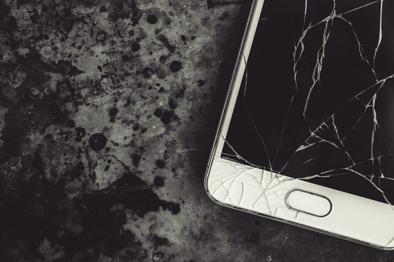 Smartphone with a broken screen.